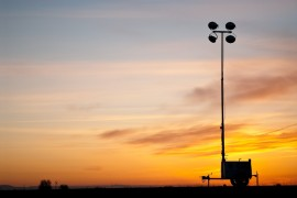 This border floodlight can be seen from the family trailer in San Luis, Arizona. Once night falls they can hear the constant humming that comes from the floodlight's generator. (Photo: Michel Duarte/Walter Cronkite School of Journalism and Mass Communication)