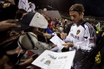 LA Galaxy midfielder David Beckham, gives autographs at the end of a match against Real Salt Lake at the FC Tucson Desert Diamond Cup in Tucson on Feb. 25, 2012. Michel Duarte/The Arizona Republic.