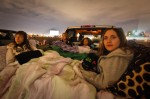 Paige Kesler (right), 13, of Litchfield Park, watches a movie with her friends at the drive-in theater in Glendale. Michel Duarte/The Arizona Republic.